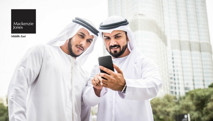 Two Local Arab Men viewing phone